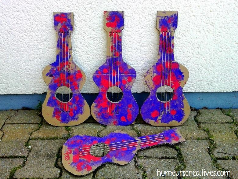 guitares en carton finies par les enfants