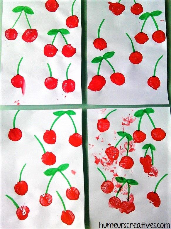 Cerises réalisées avec des empreintes de bouchons et de la peinture