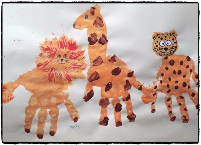 Lion, léopard et girafe en empreintes de mains