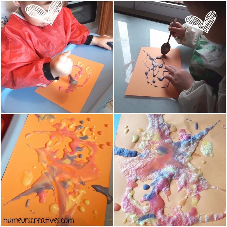 les enfants utilisent la peinture gonflante (puff paint)