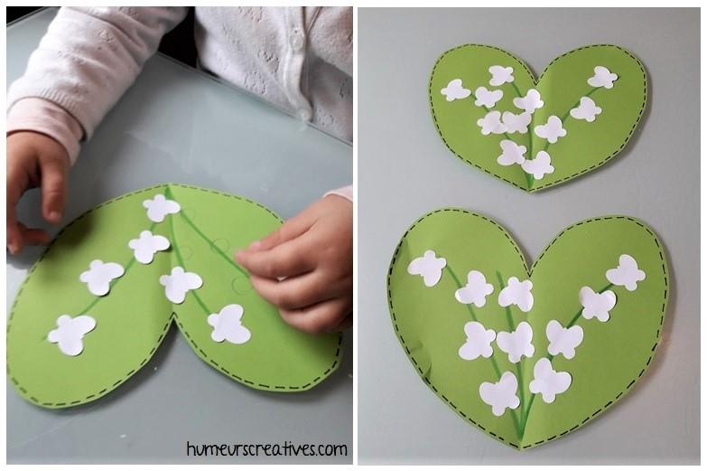 collage de papillons blancs pour former du muguet