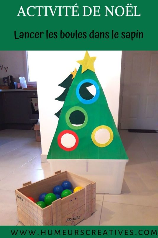 Jeu de Noël pour les enfants  : lancer de boules dans le sapin