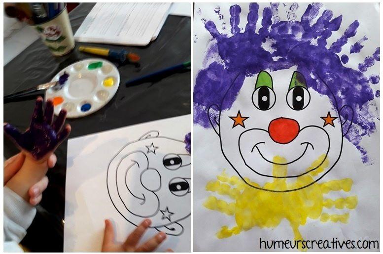 peinture sur les mains de l'enfant pour faire le clown