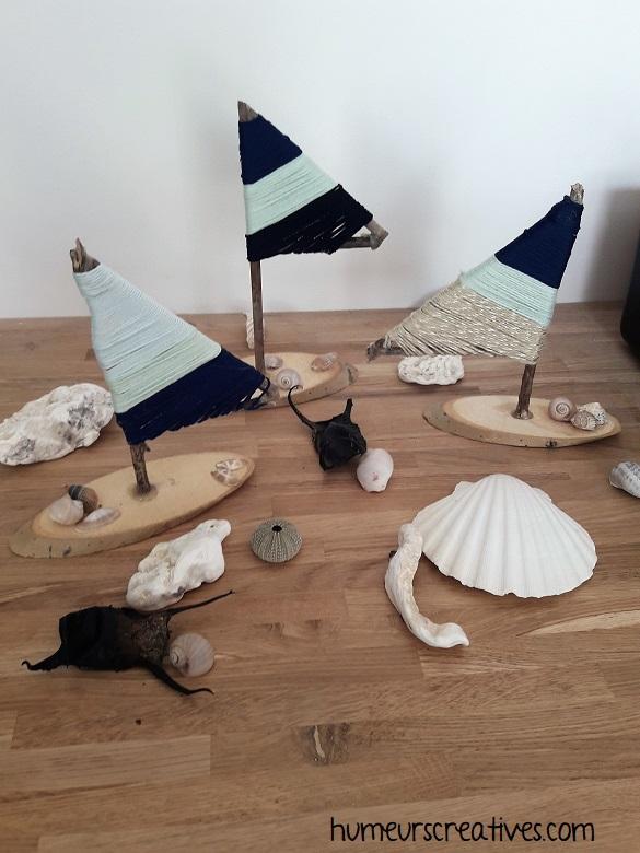 réalisation de bateaux avec du bois et de la laine