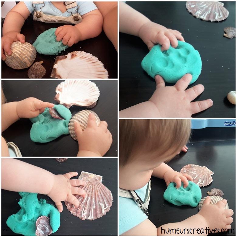 bébé participe à l'activité pâte à modeler; : il triture, et touche avec ces doigts