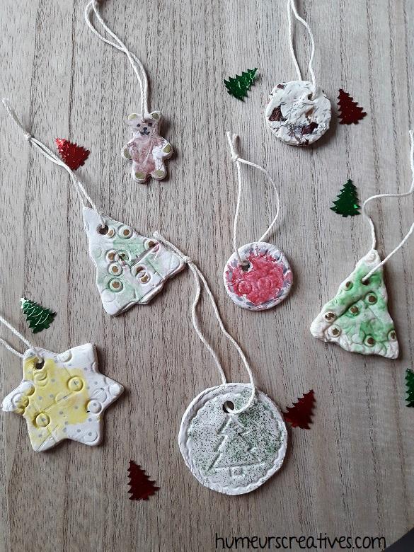 suspensions de Noël en pâte autodurcissante et pâte à sel, réalisées par les enfants