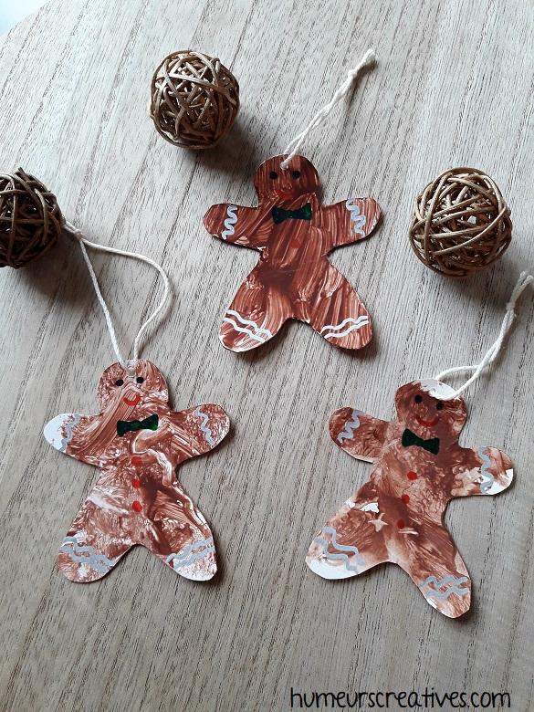 suspensions de noel en forme de bonhomme de pain d'épices réalisées par les enfants