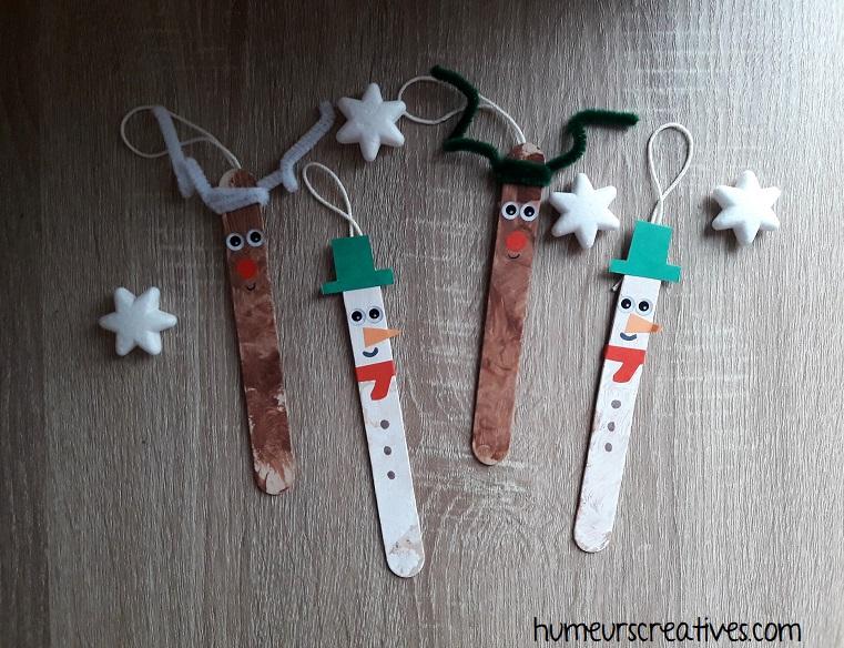 suspension de Noël réalisées avec des batonnets en bois par les enfants : bonhomme de neige et renne
