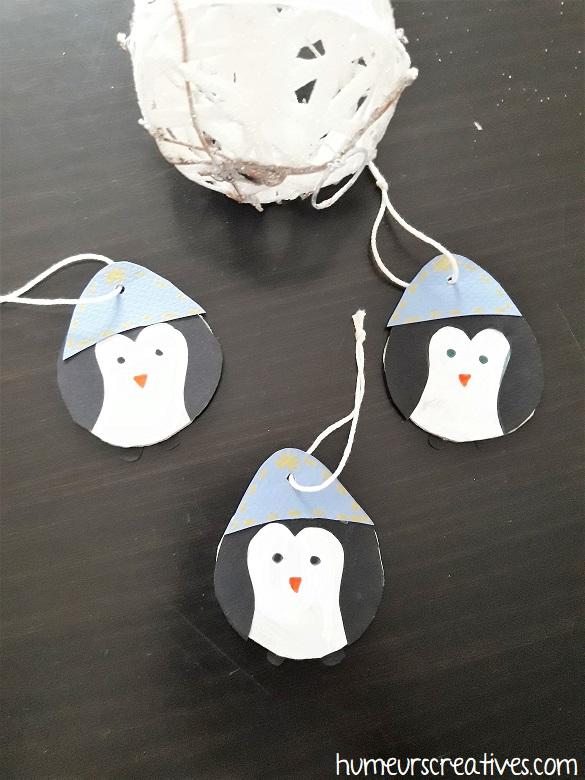 suspensions de noel en forme de pingouin réalisées par les enfants