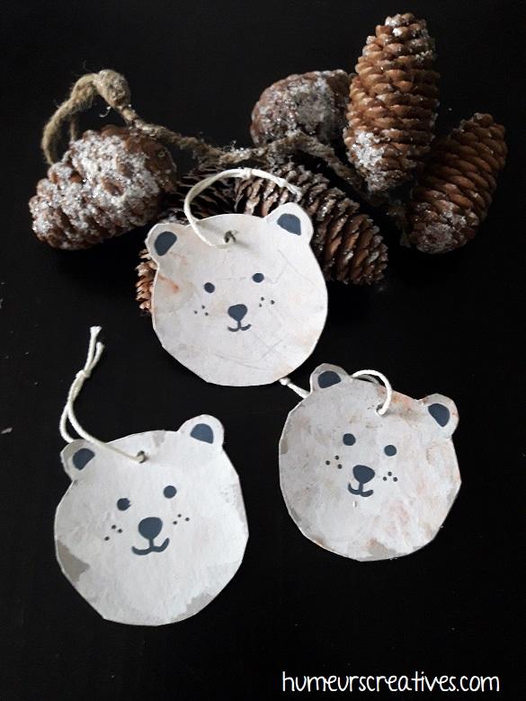 suspensions de noel en forme d'ours blanc réalisées par les enfants