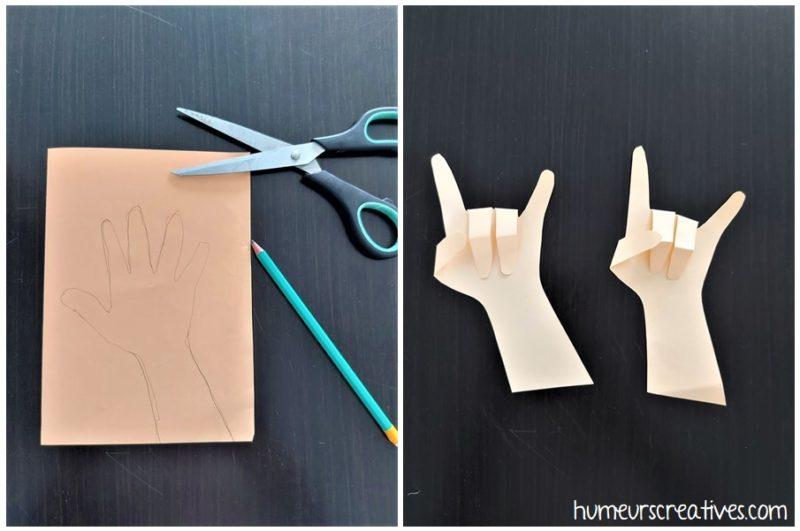 découper le contour de la main de l'enfant et former le signe des rockstar avec les doigts